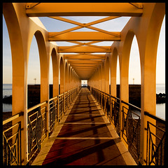 Ponte stretto (DanielaNobili) Tags: bridge sea italy beautiful lines yellow square nikon flickr mare arch shadows shot geometry award ponte clear vanishing soe cubism civitavecchia 500x500 winner500 artofimages saariysqualitypictures bestcaptureaoi freudchieracostuid danielanob bestcapturesaoi bestofmywinners elitegalleryaoi blinksuperstar blinksuperstars