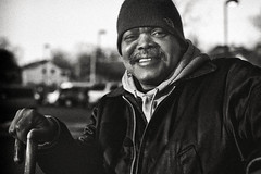 Ronnie (noir imp) Tags: street man smiling cane 35mm parking poor injury lot friendly storyteller panhandling indigent conversationalist downonhisluck badeconomy
