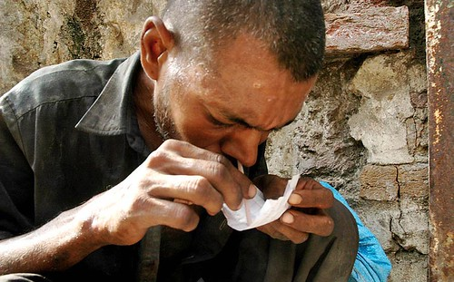 ABBOTTABAD: 25Jun2008 A Pakistani drug addict smokes heroin in Abbottabad on the eve of International anti Narcotics Day. PHOTO by Sultan Dogar