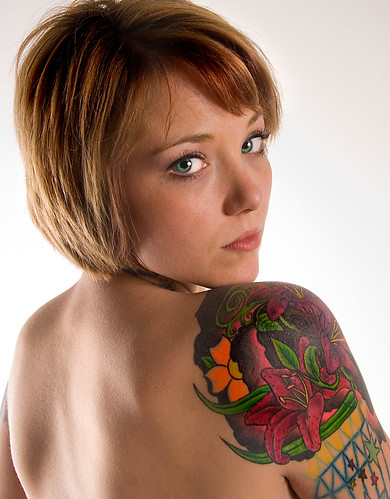 Heavy ink coverage really stands out on this girl's shoulder tattoo with