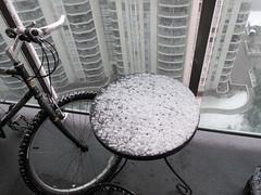 Festival of Circles (CatsFive) Tags: boy snow calgary bike table spring view balcony down bow condos 2009 catsfive