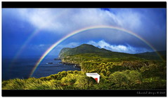 Double rainbow... (Chantal Steyn) Tags: ocean sea sky panorama storm color green nature water rain weather clouds photoshop landscape island coast rainbow nikon vegetation nikkor d300 southatlantic nohdr 1685mm goughisland
