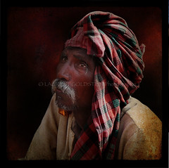 Yielding Lasting Benefit (designldg) Tags: portrait people india man photography colours market atmosphere panasonic human soul elder varanasi turban marigold soe dignity benaras humility clairobscur uttarpradesh  mywinners indiasong dmcfz18 thebestofday gnneniyisi hourofthesoul