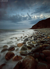 Pebbles (.Brian Kerr Photography.) Tags: sea sky mist clouds canon scotland rocks pebbles dumfriesandgalloway stninianscave eos5dmkii briankerrphotography