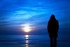 ••• (janbat) Tags: blue sunset sea woman sun mer beach yellow jaune 35mm soleil nikon bleu f2 d200 carole nikkor plage coucherdusoleil charentemaritime lacoubre jbaudebert