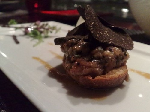 Some dish with pork and truffles on bread