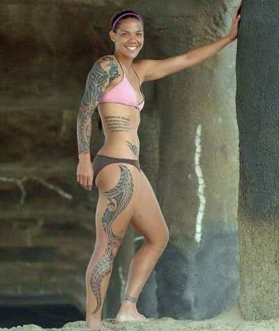 No, seriously, check out those tattoos. Natasha Kai