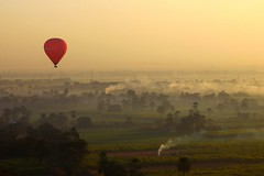 Hot air ballooning over the Valley of the Kings (... Arjun) Tags: africa morning trees red sky 15fav mist hot topf25 fog 1025fav 510fav sunrise river landscape gold dawn iso100 view smoke air balloon over dream egypt 100v10f nile kings 2550fav 500v50f valley 50100fav stunning hotairballoon 1000v100f luxor 2009 ballooning valleyofthekings dreamscape f9 hotairballooning 105mm valleyofthequeens canonef24105mmf4lis bluelist 100200fav canoneos5dmarkii canon5dmarkii