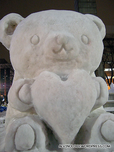 Cute-looking bear with a heart