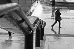 rail + rain (el_mo) Tags: sky white man black reflection london rain statue walking square day cloudy columns trafalgar rail bigben nelson nationalgallery rainy pioggia statua londra horatio nationalportraitgallery colonna riflesso