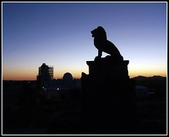 The Guardian Lion (Tony Fischer Photography) Tags: old light shadow arizona saint silhouette century twilight kino tucson profile lion mother ashes mission guardian 17th sanxavier blueribbonwinner fatherkino platinumphoto aplusphoto theunforgettablepictures theunforgettablepicture rubyphotographer