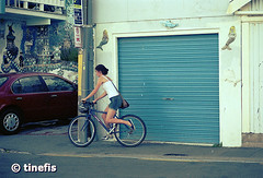 Scorching Bay, New Zealand (tinefis) Tags: newzealand people woman film girl female person olympus cycle nz filmcamera om kiwi aotearoa zuiko f4 nzl lense 200mm cycler cykla om4ti olympusom4ti newzealandphotos 200mmf4 nyazeeland nzphotos cyklist zuiko200mmf4 nzimages newzealandimages imagesofnewzealand nzphotography newzealandphotography photoofnewzealand