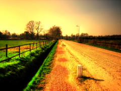 Lonely Road (Christiaan Leever NL) Tags: light orange strange photoshop warm atmosphere mysterious hdr photomatix