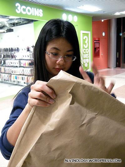 Meiyen unwrapping her 300 yen mystery bag