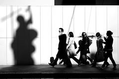 Beginner Dialogues (Donato Buccella / sibemolle) Tags: street people blackandwhite bw italy milan walking shadows candid milano streetphotography duomo armani viamanzoni canon400d keep12 sibemolle armanibuilding fotografiastradale