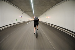 tunnel inspector (Toni_V) Tags: motion blur bicycle cycling switzerland movement highway bravo europe suisse zurich perspective tunnel autobahn fisheye merlin singlespeed roger zrich 2009 westfest d300 105mm uetlibergtunnel toniv westumfahrung favemoifrance reflectyourworld whileskatingshot httpwwwwestumfahrungchpages