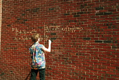 Calculus is Better Outdoors (zoevanburen) Tags: school boy man color brick wall writing person chalk education nikon class math learning teaching lesson d200 calculus teach hawaiianshirt learn
