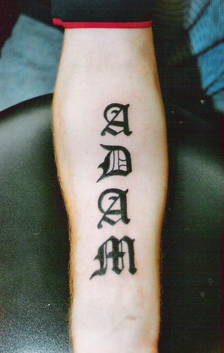 name tattoo in gothic letters on forearm by dublin ireland tattoo artist