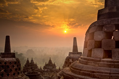 Borobudur Sunrise HDR (Alexander Ipfelkofer) Tags: morning travel light mist beautiful fog architecture sunrise indonesia landscape temple volcano java ancient ruins meditate buddha stupa buddhist magic religion unesco adventure mystical yogyakarta discovery hdr borobudur worldheritage nationalgeographic magelang borobodur historicalsites travelphotography jogyakarta