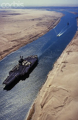Ismailia (abdoelfangary) Tags: africa ship egypt middleeast nobody transportation aircraftcarrier warandmilitary watercraft warship viewfromabove nuclearaircraftcarrier suezcanal militaryvessel nimitzclassaircraftcarrier ussnimitzaircraftcarrier