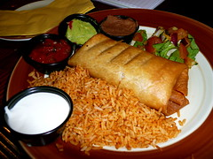 Chimichanga at Chiquito (Scorpions and Centaurs) Tags: england food restaurant yummy miltonkeynes sauce plate delicious pork mexican meal dining guacamole barbeque salsa tortilla chimichanga sourcream sides chiquito sizzling mexicanrice ribmeat