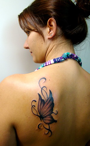 Pretty Girl back with tattoo butterfly