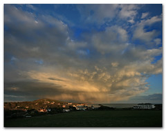 Storm clouds over Freshwater Bay, Isle of Wight (s0ulsurfing) Tags: ocean blue light shadow sea sky cloud sunlight storm beach nature water weather silhouette clouds dark landscape island bay coast skies moody natural bright wind foreboding menacing wide silhouettes dramatic wideangle stormy coastal vectis isleofwight cumulus coastline brooding gloom tempest isle 2009 cloudscape channel englishchannel wight turbulence freshwater lamanche westwight 10mm freshwaterbay turbulent sigma1020 s0ulsurfing abigfave aplusphoto vertorama