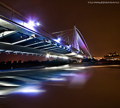 More than meets the eye (Charles Gaisano) Tags: bridge travel trip night shot long exposure reflection canon putrjaya vacation water lights red sky malaysia 400d transformer architecture perspective explore dri hdr flare uwa purple city adventure charlesgaisano