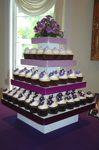 I love this wedding cupcake tower by Cupcake Chic