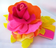 felt multi rose headband (Beyond.the.Box) Tags: pink blue orange rose yellow buttons blossoms felt peony piston handcrafted handsewn brightcolors etsy headband glassbeads hotpink feltflowers hairaccessory thinkoutsidethebox flowerheadband handembroidery childrensaccessories thinkoutsidethebox2008 feltbouquet neoncoloredfelt girlshairjewelry layeredfeltflower