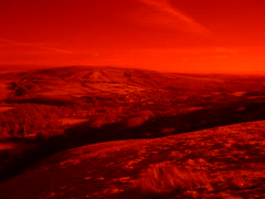 1000FT UP, langholm - in infra-red colour. (the water watcher 05.) Tags: light shadow red blackandwhite colour rural landscape ir scotland landscapes countryside town village view hill hills views infrared moors pastoral moor lightandshadow borders hilltop moorland dumfriesandgalloway dumfriesshire langholm fujifinepixs5600 ir72 infraredcolour themuckletoon midhill timpen fujis5600ir72 thelangholmwalks