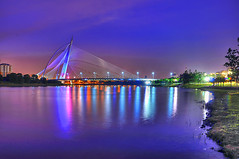 A Bridge Too Far : HDR : (DELLipo) Tags: city longexposure travel bridge blue light sunset urban favorite reflection beauty architecture night photoshop reflections dark lights evening nikon nightshot tripod wide symmetry explore malaysia putrajaya dslr capture hdr finest hdri selangor lightmagic photomatix jambatan tonemapping tonemap d80 1024mm malaysiahdr hdellr