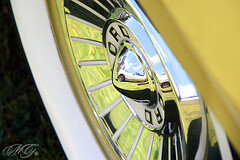 Car Show 6 (Marcie Gonzalez) Tags: auto show california park lighting county old light orange white hot color detail reflection green classic cars ford beach colors up car wheel yellow metal wall canon vintage reflections photography automobile colorful paint close natural display parts painted huntington details parks tire southern part chrome classics coloring rod shows antiques gonzalez collectors oc upclose rods hubcap section shinny automobiles marcie collecting collector metals classy hubcaps chromed anitique chroming colllect marciegonzalez marciegonzalezphotography