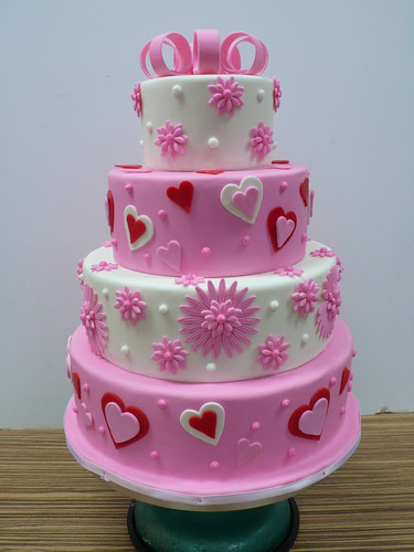 pink and white flowers hearts wedding cake