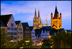 Kln - The Spires of Klner Dom and Gro St. Martin Above Traditional Houses (Yen Baet) Tags: travel bridge architecture reflections germany deutschland europe cathedral spires religion gothic cologne kln christianity catholicism rhein rhineriver klnerdom hohenzollernbrcke hohenzollernbridge twililght churchesofeurope grosstmartin greatstmartinschurch