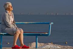 Red shoes are resting (adartee   www.imik.it) Tags: sea italy beach bench pier seaside sand italia mare oldlady spiaggia molo riccione sabbia panchina anziana signoraanziana