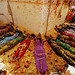 Hindu worshipers offered prayers in front of a temple surrounded with rice and flowers, offerings to the god Shiva during a local festival in Suryapet, India. Photo- Mahesh Kumar A.:Associated Press