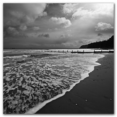Wash it all away - Shanklin, Isle of Wight (s0ulsurfing) Tags: ocean wood light sea wild sky blackandwhite bw cliff cloud sunlight white seascape black beach nature water beauty weather clouds contrast square grey mono bay coast march wooden sand waves skies natural wind wide perspective shoreline fluffy wave wideangle monotone cliffs wash coastal filter shore foam cumulus coastline backlit humilis grad groyne 2009 squared nube shanklin bold meteorology nephology 10mm wavelet sigma1020 nd4 sandownbay s0ulsurfing cumulushumilis aplusphoto vertorama eastwight