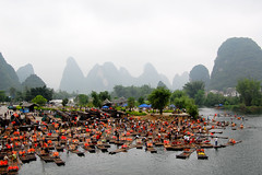 traffic jam on the river (marin.tomic) Tags: china wood travel mountains water river asian boats countryside boat nikon asia traffic guilin yangshuo country chinese bamboo hills explore raft jam karst gettyimages guangxi d40