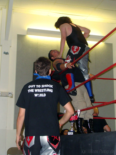 As Notorious E.V.A.N. Evan Gelistico looks on, his tag team partner Point Blank Pierre Abernathy delivers a beating to Shawn Allen. Photo by Kari Williams