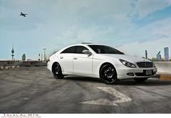 Mercedes Benz CLS (Talal Al-Mtn) Tags: 2005 city blue sky white plane canon mercedes benz shot d parking 2006 class e mercedesbenz motor kuwait 2008 450 2009 v8 2007 v6 cls q8 v12 kwt clsclass 450d mercedesbenzcls canon450d inkuwait talalalmtn