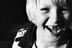 A laugh is a smile that bursts ( feelium ) Tags: blackandwhite bw smile robin smiling d50 kid nikon child laugh laughting childeren
