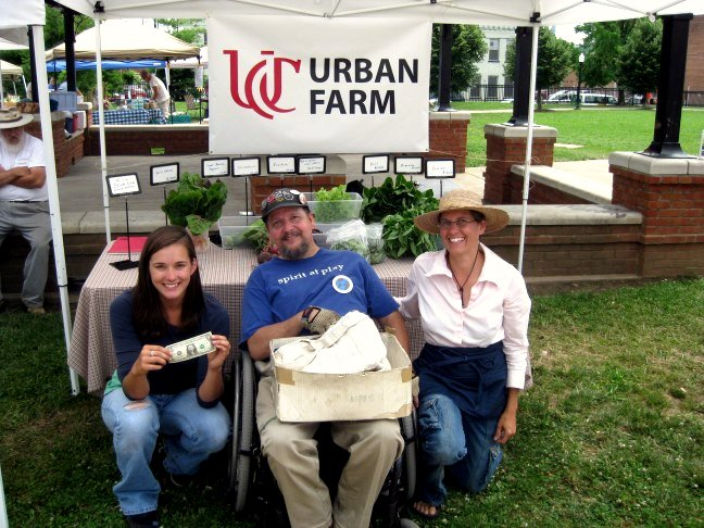 (photo of UC booth at Northside farmers' market)
