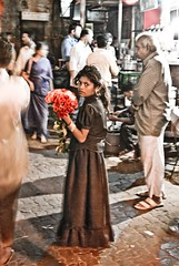 Alone in the crowd (Mathieu [swallowed by offline life, will be back]) Tags: flowers india girl child market crowd bombay mumbai abigfave impressedbeauty petiteshistoiressansparoles
