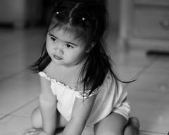 Looking forward (Jun See) Tags: portrait baby girl canon blackwhite kid photographer child uae filipino segundo 50mmf18 activeassignmentweekly blockedflickr junsee