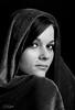 The Look (FLPhotonut) Tags: lighting portrait woman texture mystery pose blackwhite eyes pretty florida flash breathtaking onblack homestudio tabbi canon350xt interfit150ex flphotonut interfitex150mkii