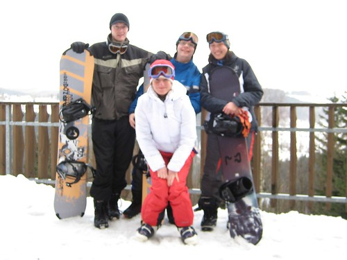 Three snowboarders and a skier