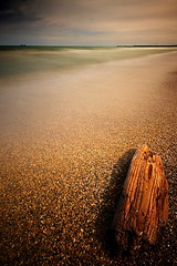 IMG_6443 (Uggla) Tags: longexposure chicago seascape 20d beach nature canon landscape sand waves lakemichigan driftwood filter uggla torkel slowwater sigma1020 daytimelongexposure ndgrad 24seconds nd3 nd1000 cokin121s 10stopnd torkeluggla nd100