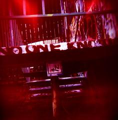 Free Wall Secrets (liquidnight) Tags: seattle red streetart colour 120 film stairs mediumformat graffiti iso100 holga fuji stickers steps slidefilm lightleak velvia fujifilm railing fujichrome nok sodo sn 120cfn rvp100 legalwall ephemeralart nooneknows freewall slightlynorth