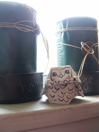 little egg carton owl between the tin herb planters